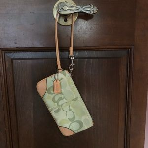 COACH light green wristlet